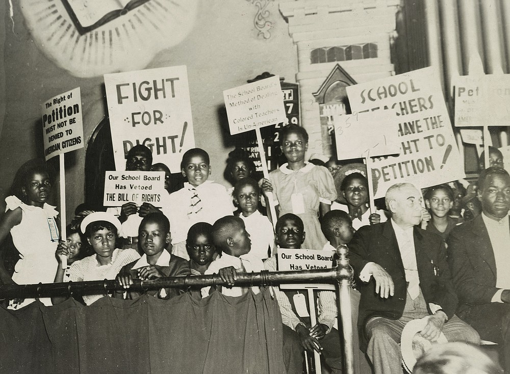 """Fighting for the Right to Fight: African American Experiences in WWII,"" on display starting Tuesday Jan. 19 at the University of Arkansas-Pulaski Technical College, includes images of school children protesting treatment of Black teachers in Norfolk, Va., June 1939. (Special to the Democrat-Gazette/courtesy Library of Congress)"