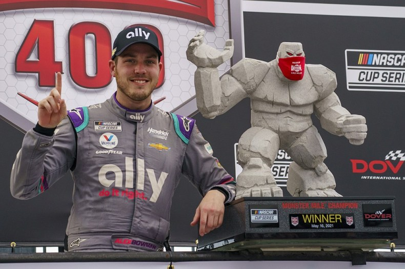 Alex Bowman celebrates the win following a NASCAR Cup Series auto race at Dover International Speedway, Sunday, May 16, 2021, in Dover, Del. Alex Bowman wins the race. (AP Photo/Chris Szagola)