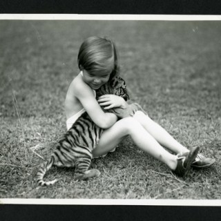 1930s little girl with her pet tiger cub