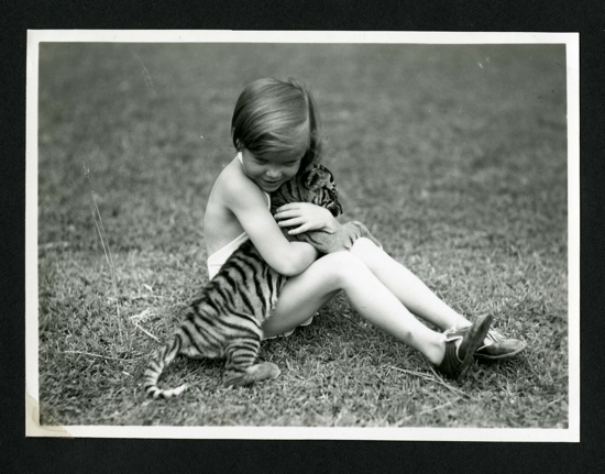 1930s photo girl and pet tiger cub