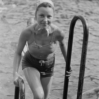 Young girl in a knitted 1950s bikini