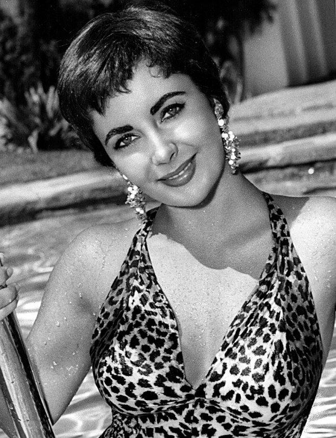 Elizabeth Taylor with short hair in a leopard print swimsuit