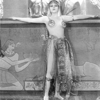1920s movie actress Theda Bara as Cleopatra (in very risqué costumes)