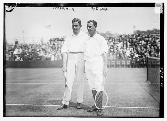 Playing tennis in plus fours and long trousers in 1915