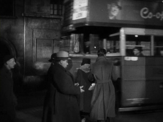 This is Hitchcock's famous cameo moment in The 39 Steps