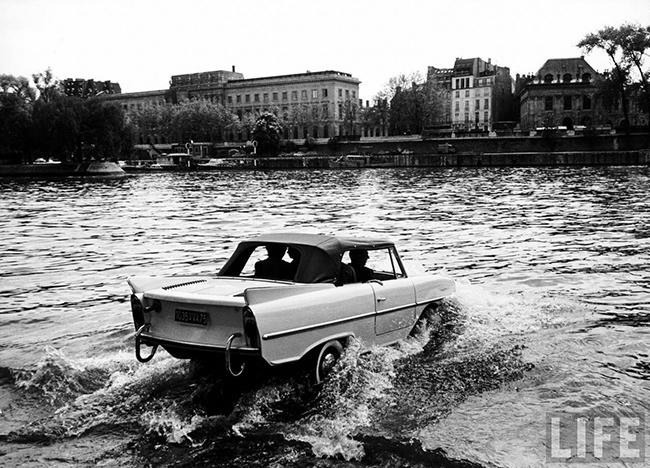 Driving an amphibious car into the river Seine. 1960s