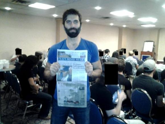 Roosh V: Either he's just given a talk or he's being held hostage by a couple of dozen dudes