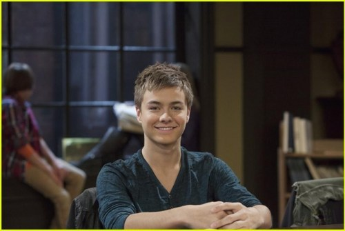 Lucas from Girl Meets World smiling vacantly
