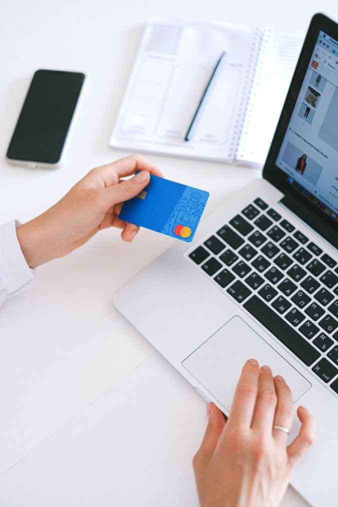 Woman hand shopping from website using credit card