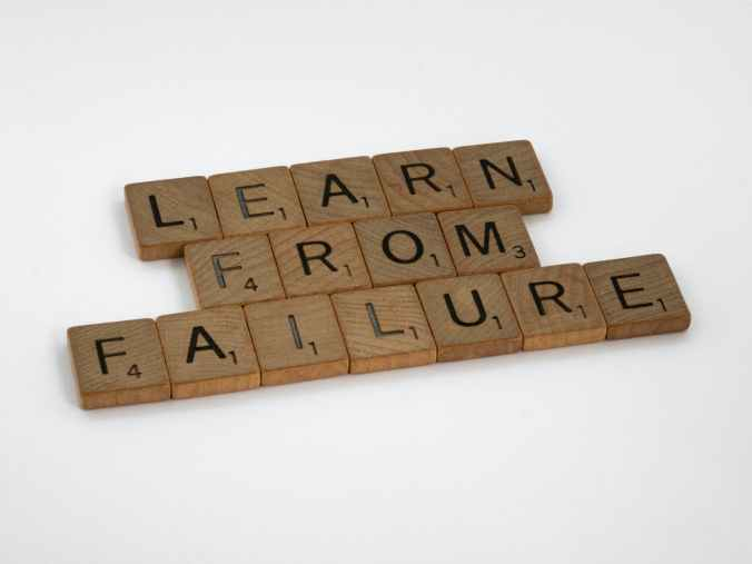 wood typography photography about learn from failure - strive for progress not for perfection