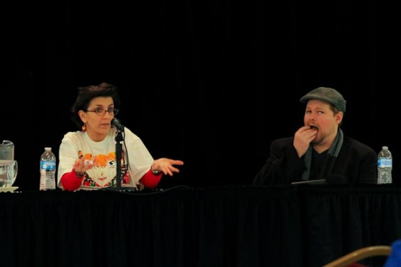 Chris sneaks a bite of cookie during Tiffany's panel on Adapting Scripts