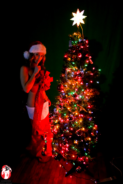 Silent Night - The lovely Kim sweetly demands silence while waiting for Santa's Surprises