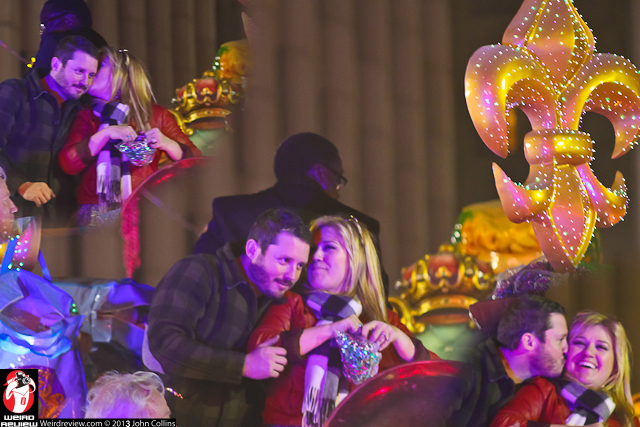 Kelly and Brandon exchanging kisses during the 2013 Endymion Parade