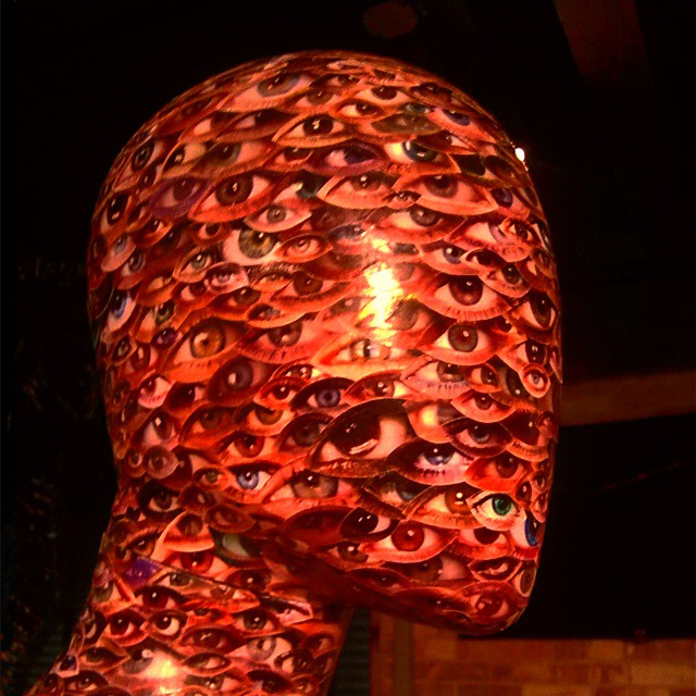 The face of the sculpture representing sight is devoid of scuplted eyes, nose, ears, and mouth