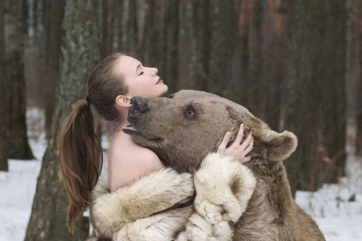 Russian Models Pose with a 1,400 Pound Bear For Anti-Hunting Campaign