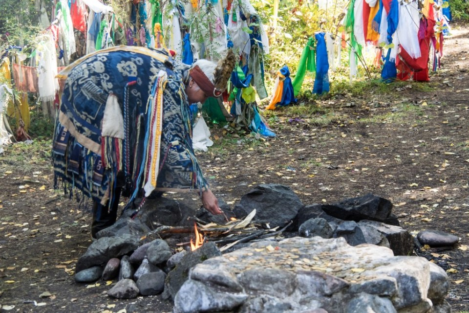 """""""Republic of Tuva"""" Siberia, kamlanie, ritual, Russia, Shaman, Sjamaan, Tuva   Welcome to the shaman. Shaman - ceremony Shamans'kamlaniye - Kamlanie is a magical communication between shamans and spirits. Accompanied by the sound of drum, the shaman emits sounds resembling to voices of a crow or a cuckoo-bird. These are magical birds which empower the shaman to sing his incantations. He is sitting backwards to the fire , monotonously beats his drum and has  a conversation with his supporting spirits.  Finally he banishes evil spirits away or claims  the situation to be fatal. Whatever the outcome of the kamlanie is, the shaman makes sacrifice to his spirit-helpers with spraying milk over four directions and burning pieces of meat and bread.  This rite can be of two kinds : the one of healing and the one of worship: worship of fire, worship of sacred trees or worship of patron of a clan. The kamlanie is held according to regular and fixed scheme: purification - invocation of necessary spirits - searching for the reason of a desease or ritual consecration processing - hostile spirits exorcism - fortune-telling of the results of the kamlanie or the future of presented people. Photo by  Rita Willaert/Flickr"""