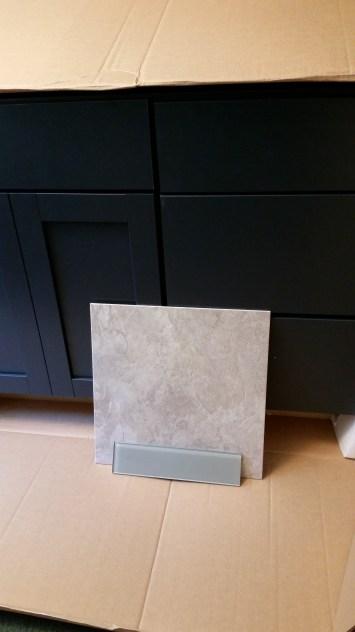 Glass tile, floor tile (vinyl), and vanity (marine blue, very dark)