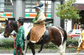 Archery on horseback with their costumes on