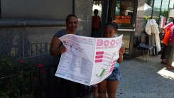 Mother and daughter check out the list of activities for Boogie on the Boulevard's first Sunday!