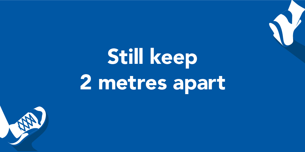 """Still keep 2 metres apart"" text in Manchester City Council COVID blue branding."