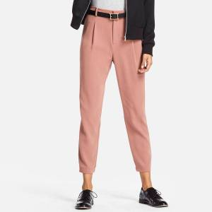 Uniqlo 2017 drape collection jogger pants stock photo. The pants are pink and have pleats.
