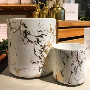 CB2 marblelized ceramic planters. They look like they're made out of white and gold marble.