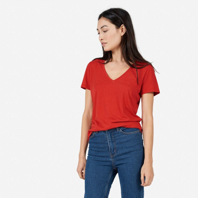 Everlane cotton v tee in red, as worn by a white woman with dark hair.