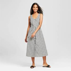 Target who what wear cut out dress in gingham, as modeled on a brown woman with brown hair.