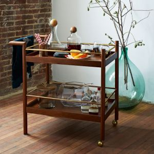 West Elm mid century bar cart. It is made out of wood.