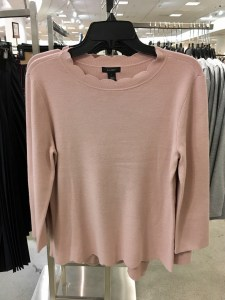 Halogen scallop edge sweater, part of the Nordstrom Anniversary Sale. It is pink and has scalloped hem and neckline.