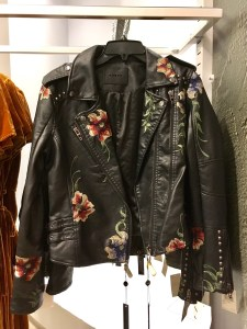 BlankNYC faux leather jacket with boho flair. It has flowers embroidered on it.