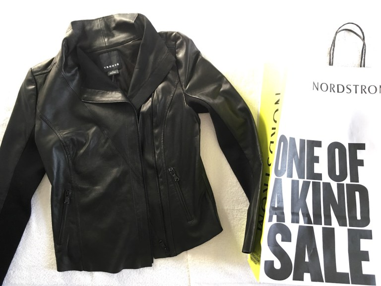 "Black Trouve leather jacket and Nordstrom shopping sale advertising the Nordstrom Anniversary sale as ""One of a kind sale"""