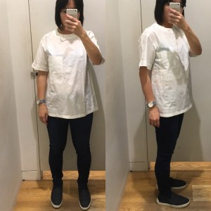 UniqloU shirt fitting room selfie. It's an ill-fitting large white shirt.