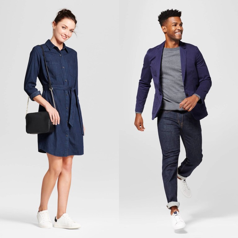 A white woman wearing a dark denim shirt dress, and a black man wearing a T-shirt and jeans with a blue blazer
