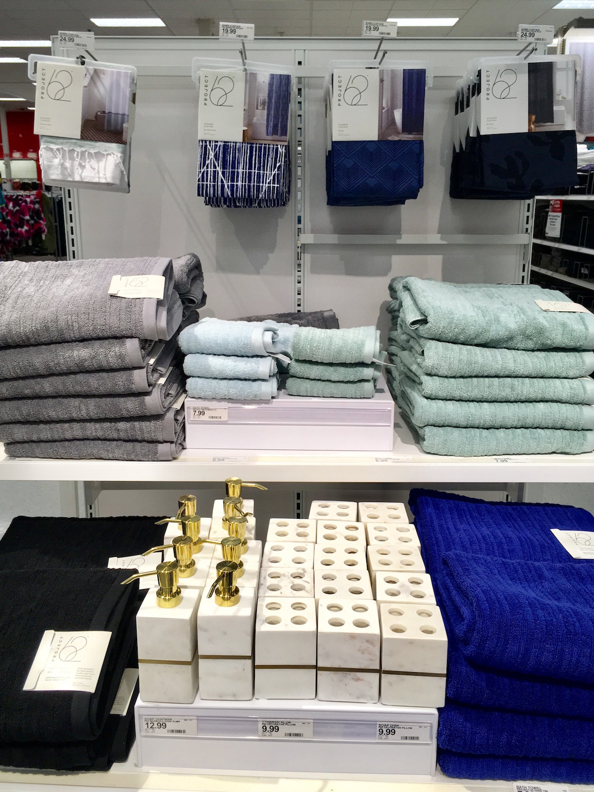 Display Of Project 62 Shower Curtains, Bath Towels, And Toothbrush Holders.