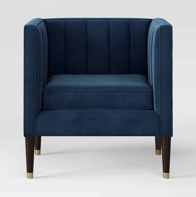 armchair with high arms, square shaped, tufted back.