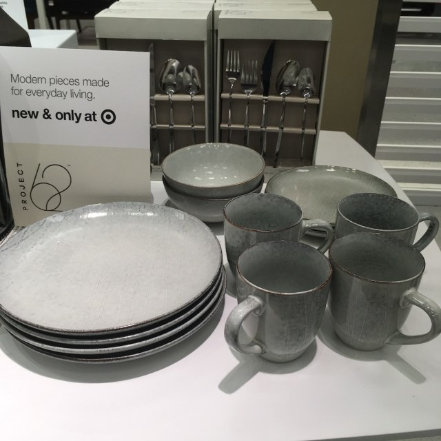 Ceramic dish set consisting of bowls, plates, and mugs in a gray blue color. Surface has texture with organic lines.