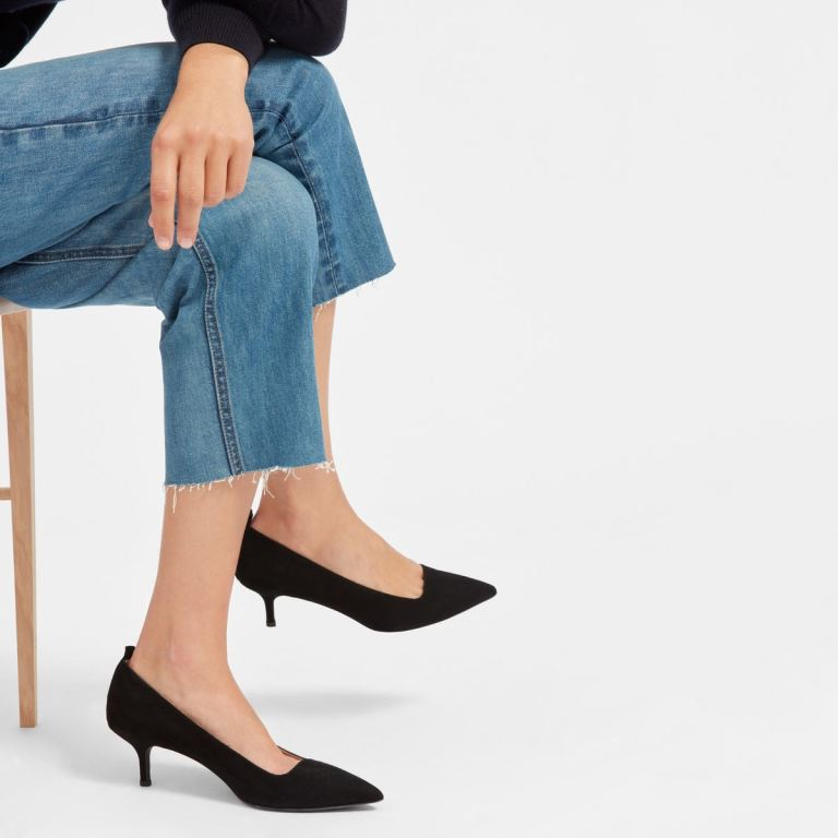 Everlane editor heels in black, as shown on a model's feet.