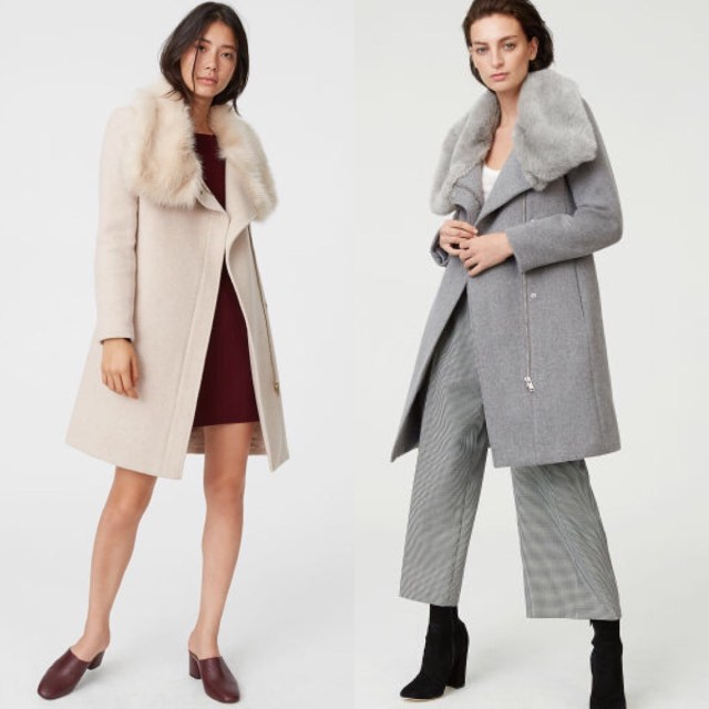 Models wearing the Evangah Coat from Club Monaco. Model on left is an East Asian woman wearing the pink-ish version. Model on the right is white woman wearing a gray version. The coat is wool and has a faux fur collar.