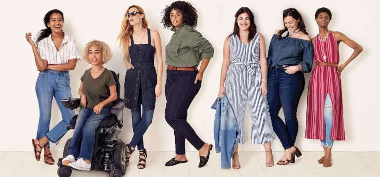 7 women of all different shapes and sizes, including one in a wheel chair, wearing Universal Thread, Target's new denim line.