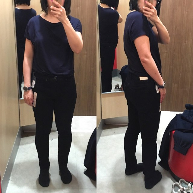 Me a petite Asian woman, trying on high-rise skinny jeans in a Target fitting room. There are two selfies side by side, one of the front and one of the back view of the jeans.