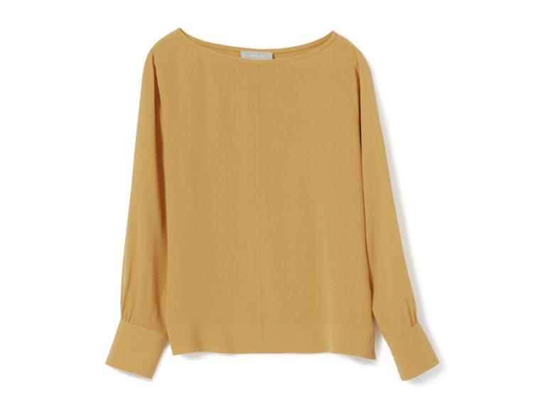 Stock photo of the Everlane Clean Silk Boatneck blouse in mustard gold.