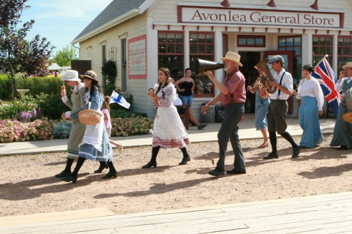 This is a photo of Avonlea Village in Cavendish. All the characters are taking part in a parade.