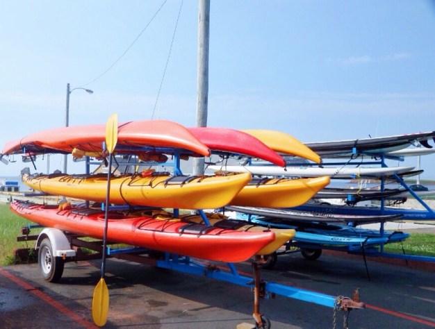 Racks Piled high with Kayaks and Paddleboards