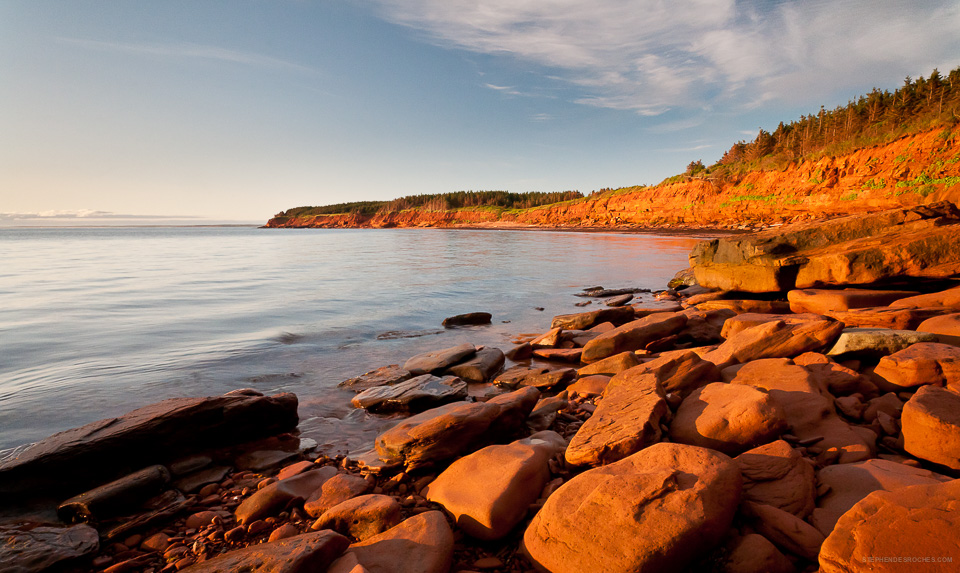This is a photo of red sandy cliffs in Cavendish National Park on Prince Edward Island