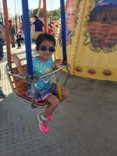 Riding Swings at the fair