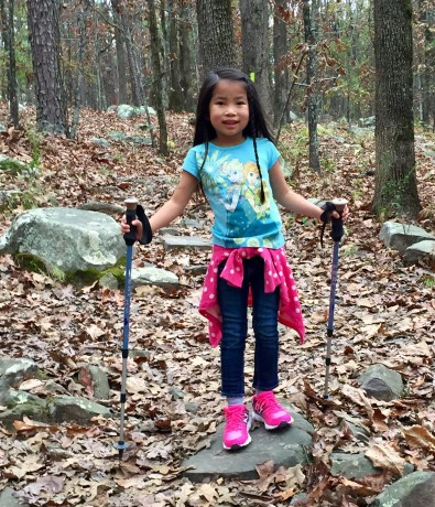 She loves using Mommy's hiking poles... I mean the hiking poles that previously belonged to Mommy