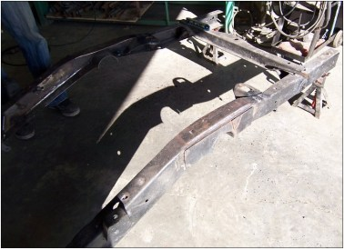 Clean the frame rails to prepare for the step notches.