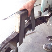 Set the notch on the rail to determine where to trim the lower legs.