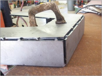 The tabs keep the plates corner-to-corner for optimal weld condition.